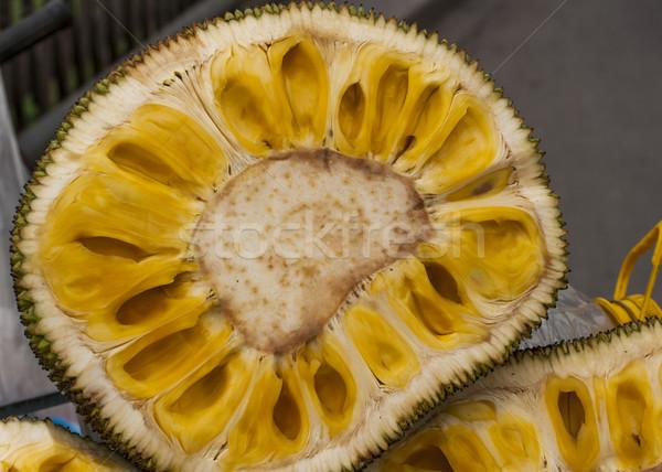 Közelkép vág fél narancs citromsárga gyümölcs Stock fotó © Klodien
