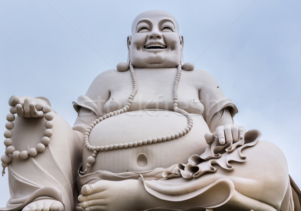 Massive white sitting Buddha statue isolated from decor.  Stock photo © Klodien