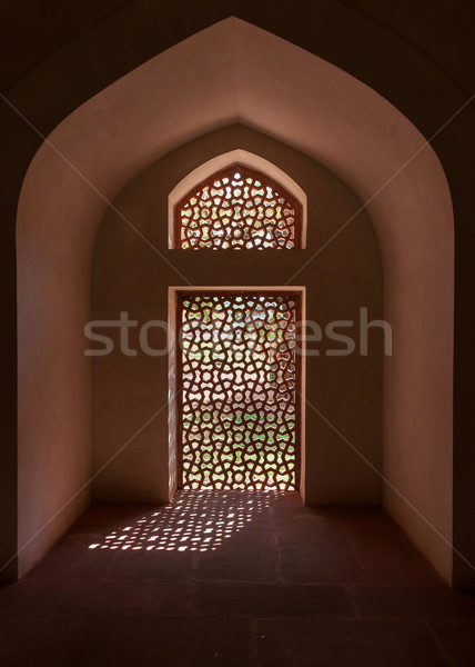 Alcove with stone screen in window at the Humayun tomb in New De Stock photo © Klodien