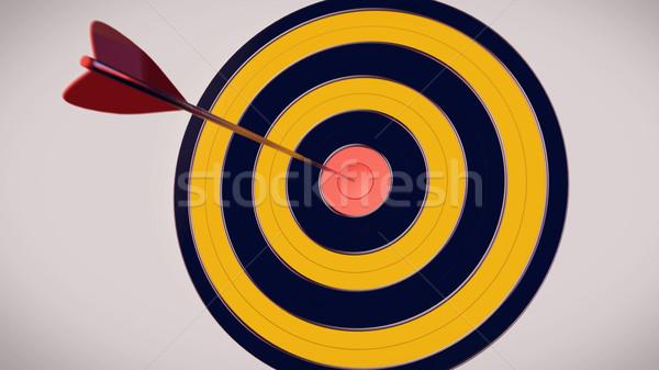 Red dart arrow hitting in the target center of dartboard Stock photo © klss