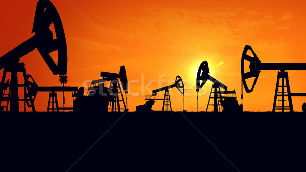 Silhouette pump jacks at sunset.  Stock photo © klss