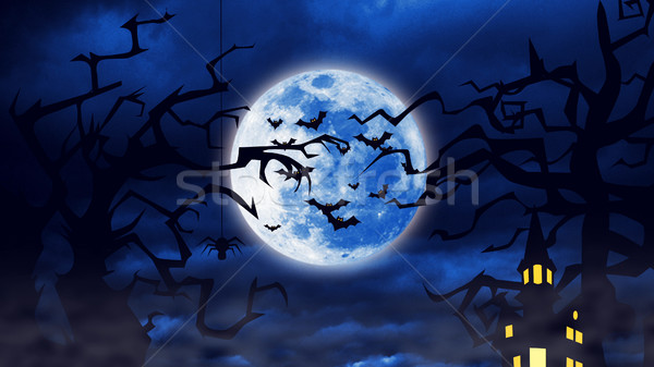 Flock of the creepy bats are flying with a full moon behind them. Stock photo © klss