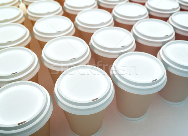 A row of paper coffee cups on a white background. Stock photo © klss