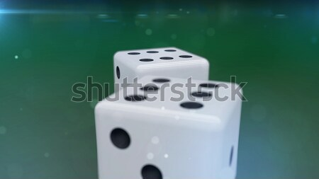 Two dices on a green background showing a five Stock photo © klss
