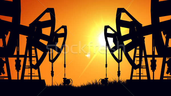 Silhouette pump jacks at sunset. Oil industry.  Stock photo © klss