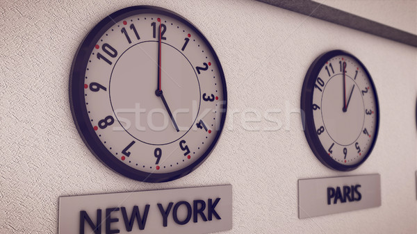Clocks on wall, symbol for Greenwich Mean Time Stock photo © klss