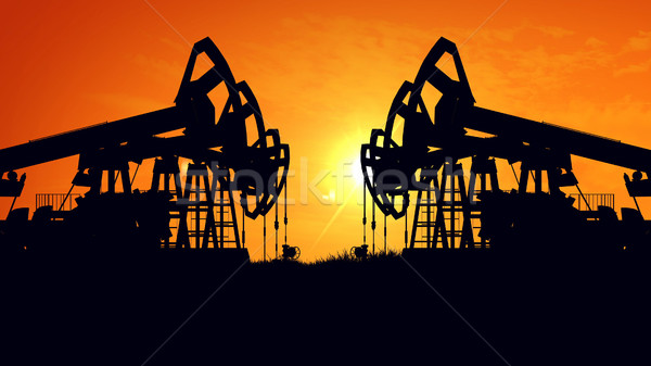Oil pump oil rig energy industrial machine for petroleum in the sunset Stock photo © klss