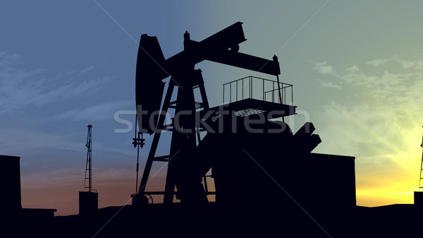 Oil pumps at sunset. Oil industry equipment. Stock photo © klss