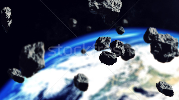 Asteroids Closing to the Earth Planet.  Stock photo © klss