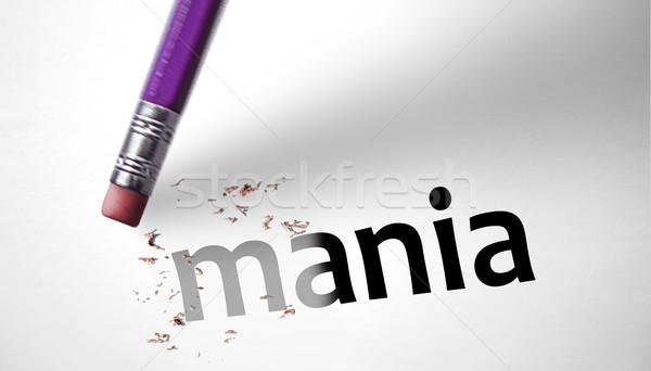 Eraser deleting the word Mania  Stock photo © klublu