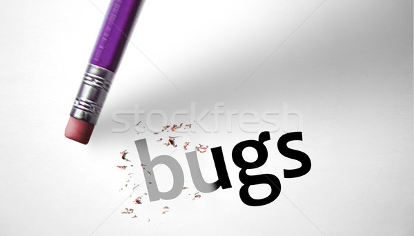 Eraser deleting the word Bugs  Stock photo © klublu
