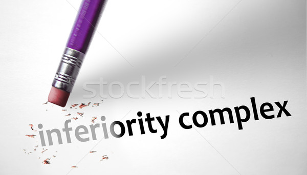Eraser deleting the concept Inferiority Complex  Stock photo © klublu