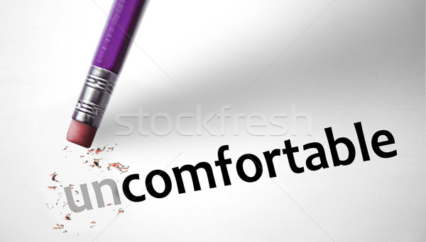 Eraser changing the word Uncomfortable for Comfortable  Stock photo © klublu
