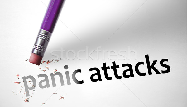Eraser deleting the concept Panic Attacks  Stock photo © klublu