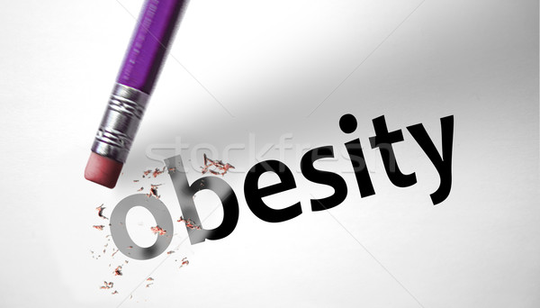 Eraser deleting the word Obesity  Stock photo © klublu