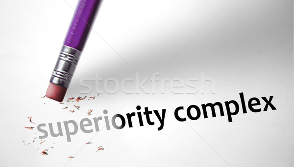 Eraser deleting the concept Superiority Complex  Stock photo © klublu