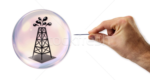 Oil value Bubble about to explode by a needle  Stock photo © klublu