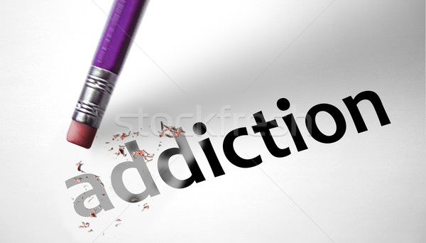 Eraser deleting the word Addiction  Stock photo © klublu
