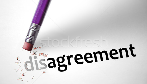 Eraser changing the word Disagreement for Agreement Stock photo © klublu
