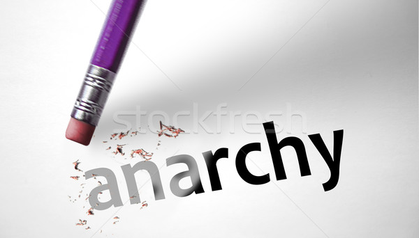 Eraser deleting the word Anarchy  Stock photo © klublu