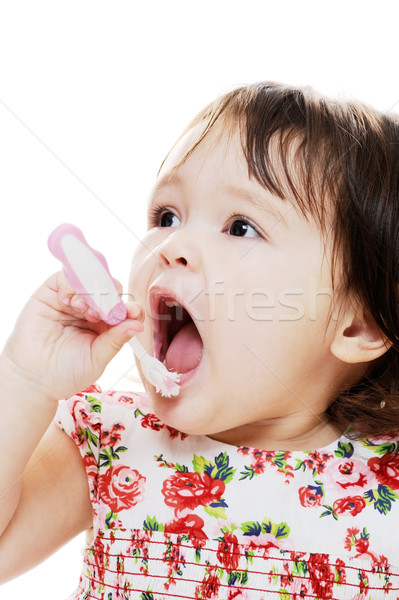 Temizlik dişler küçük kız pembe diş fırçası Stok fotoğraf © KMWPhotography