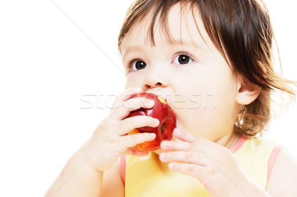 Harap alma kislány eszik friss piros alma Stock fotó © KMWPhotography