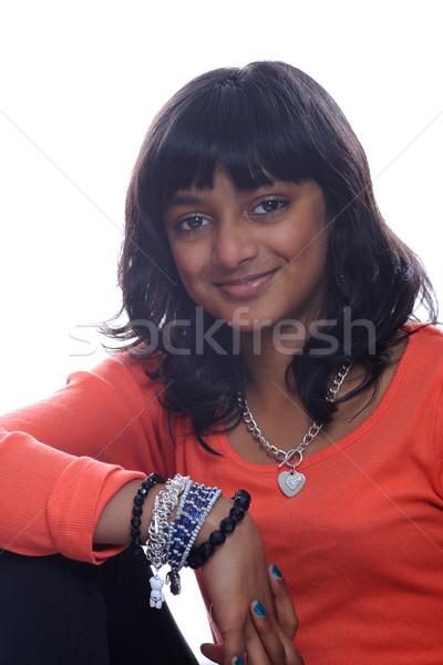 молодые азиатских девушки индийской изолированный оранжевый Сток-фото © KMWPhotography