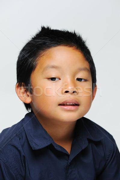 Asian jongen onschuldige naar beneden te kijken Blauw Stockfoto © KMWPhotography