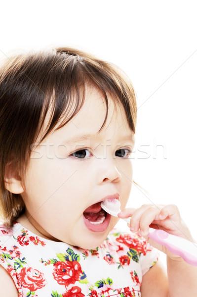 Gyermek fogak kislány fogmosás baba száj Stock fotó © KMWPhotography