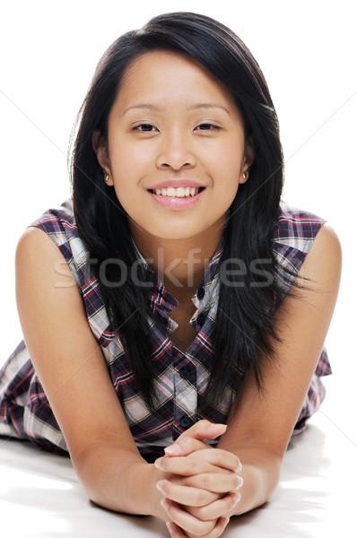 счастливым подростку улыбаясь азиатских Lady глядя Сток-фото © KMWPhotography