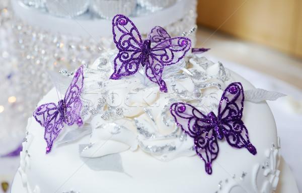 Düğün pastası beyaz mor kelebek dekorasyon Stok fotoğraf © KMWPhotography