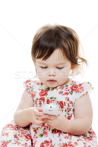 Infant girl with phone Stock photo © KMWPhotography