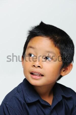 Asya erkek mavi gömlek gülen bakıyor Stok fotoğraf © KMWPhotography