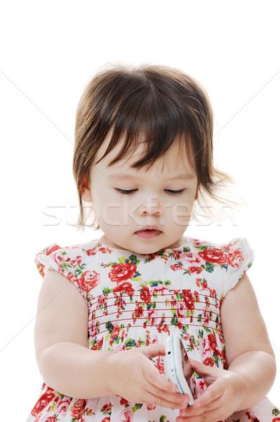 Genç bebek kız bakıyor cep telefonu Stok fotoğraf © KMWPhotography