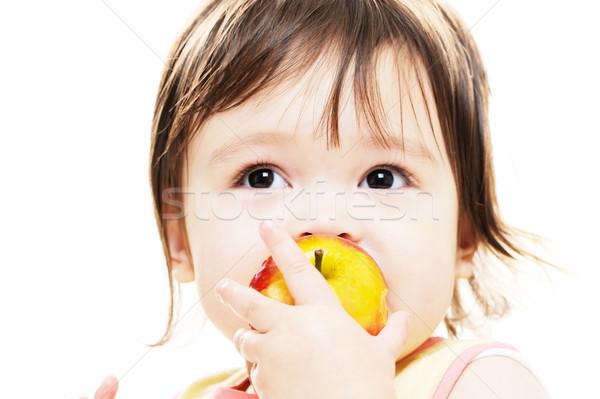 Lány élvezi alma fiatal lány harap friss Stock fotó © KMWPhotography