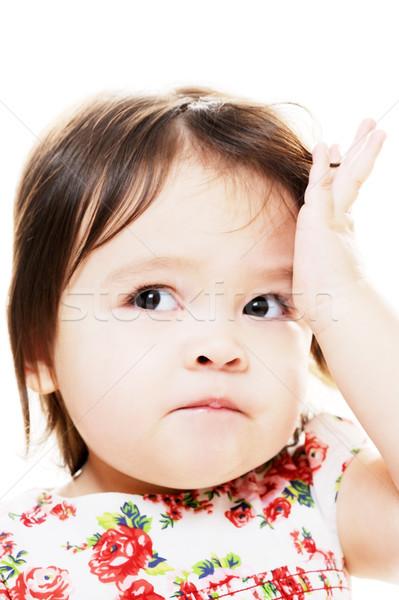 Tanácstalan lány kislány néz zavart közelkép Stock fotó © KMWPhotography