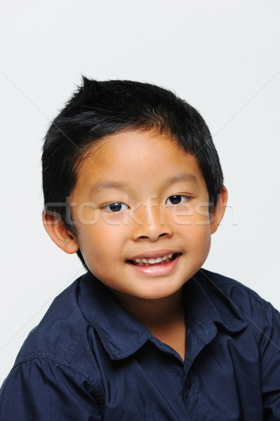 ázsiai fiú néz boldog visel kék Stock fotó © KMWPhotography