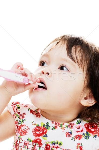 Meisje tanden jong meisje schoonmaken roze tandenborstel Stockfoto © KMWPhotography