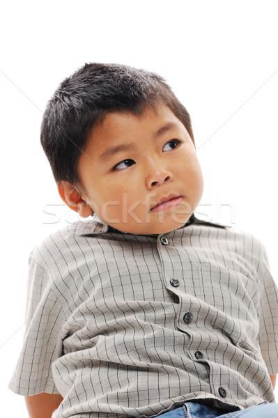 Asian boy contemplating Stock photo © KMWPhotography