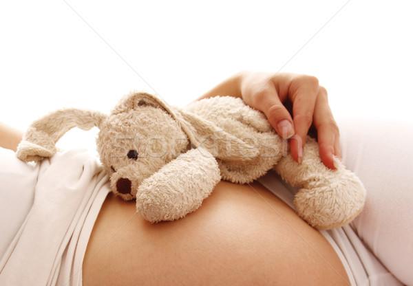 stomach pregnant woman on white background Stock photo © koca777