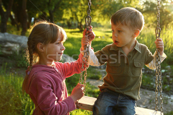 very happy childrens on a swing Stock photo © koca777