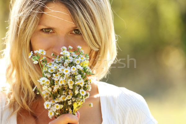 young girl with a bouquet of flowers in nature  Stock photo © koca777