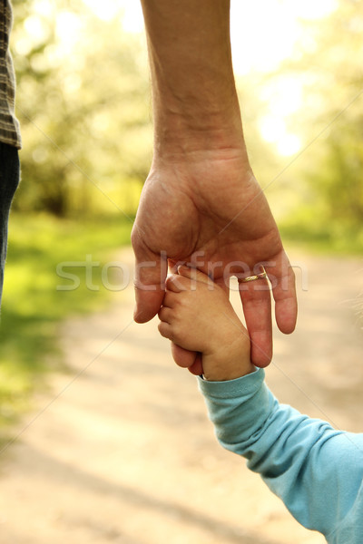 the parent holds the hand of a small child Stock photo © koca777