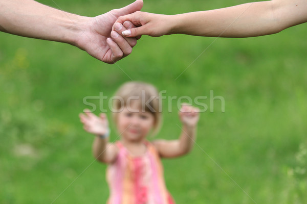 two arms of lovers and young daughter Stock photo © koca777