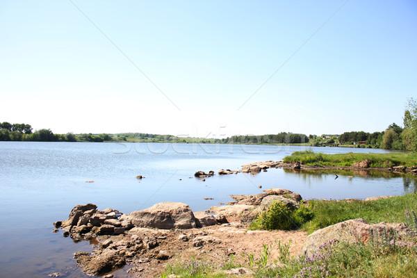 Pierres lac ciel eau soleil nature Photo stock © koca777