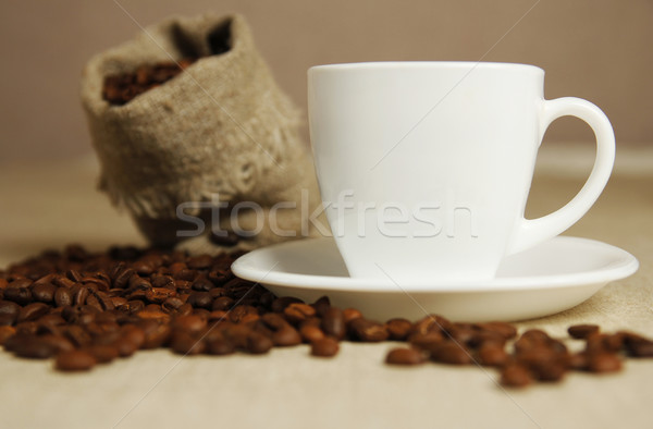 coffee mug and coffee beans Stock photo © koca777