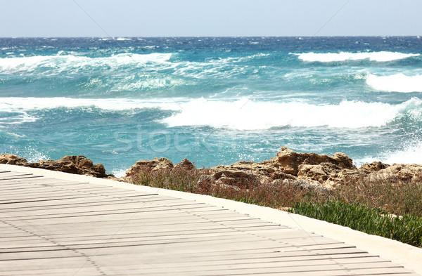Plage ciel eau homme soleil mer Photo stock © koca777