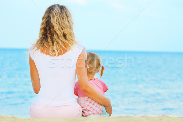 Stock photo: Mother and daughter on the sea
