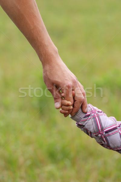 Szülő kéz kicsi gyermek család biztonság Stock fotó © koca777