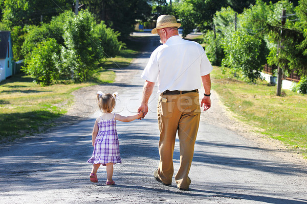 grandfather and granddaughter are on the road Stock photo © koca777